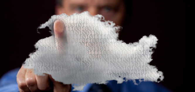 Man touching cloud computing symbol